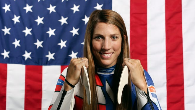 FILE - In this Sept. 25, 2017, file photo, United States Olympic Winter Games luge hopeful Erin Hamlin poses for a portrait at the 2017 Team USA Media Summit in Park City, Utah. Hamlin will carry the U.S. flag into Friday night's opening ceremony at the Pyeongchang Olympics on Feb. 9, 2018. The four-time Olympic luger was chosen by fellow Team USA Olympians for the honor. Hamlin is retiring at the end of these Olympics, after nearly two decades of racing competitively.