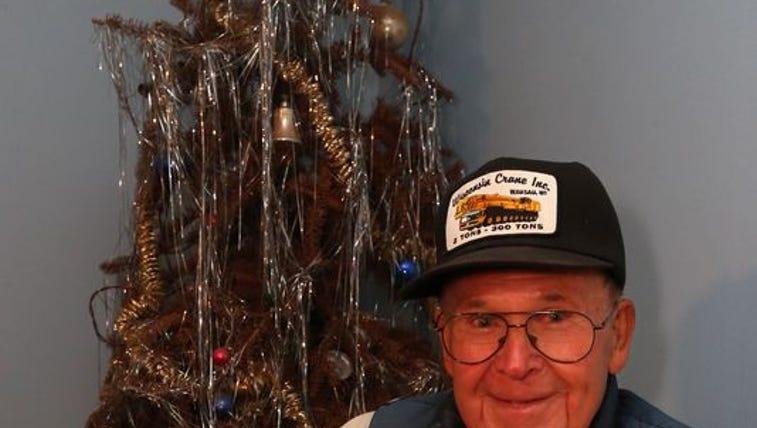 Neil Olson, 89, said he'll take down the tree when