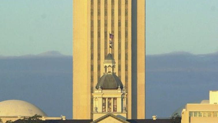 The old and new Florida Capitol are bathed in the glow
