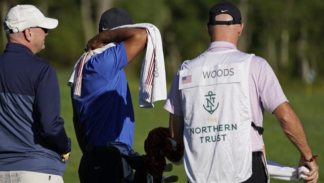 TigerWoods rubs his neck while on the driving range prior to his round of the Northern Trust golf tournament at TPC Boston, Thursday, Aug. 20, 2020, in Norton, Mass.