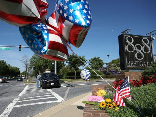 A makeshift memorial has been started near the Capital Gazette, where five people were shot and killed by a gunman June 29, 2018, in Annapolis, Maryland.