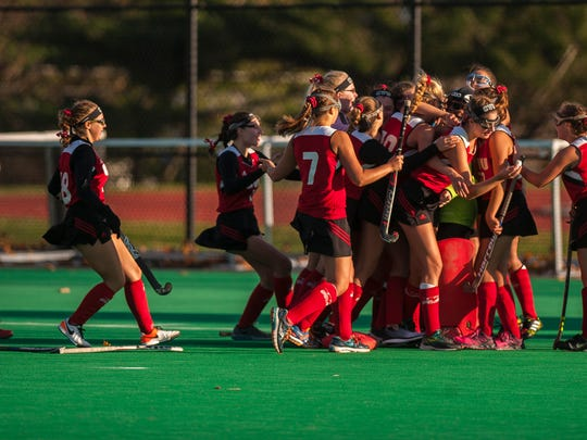 The CVU field hockey team rushes the field after winning their semi final 2-1 over Essex on Monday, Oct. 30, 2017. CVU pulled out the win, 2-1.