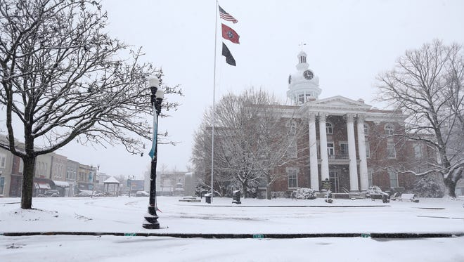 Snow falls on the Rutherford County Courthouse in Murfreesboro, on Friday, Jan. 22, 2016.