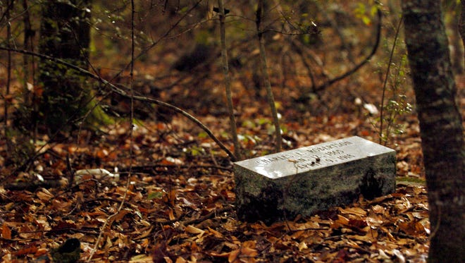 A headstone in Hookman's Cemetery in rural Acadia Parish is seen in 2010. Some suspect the cemetery is haunted.
