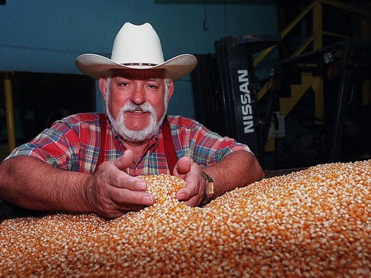 Wilfred Sieg Sr., of the Ramsey Popcorn Company and a.k.a Cousin Willie, scoops some popcorn at the Ramsey, Indiana plant in 1999. He died in 2006.