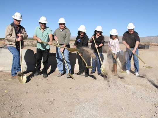 Otero County staff and engineers break ground at the