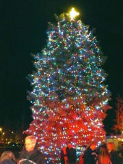 The tree is lit up for the holidays during the Pawling