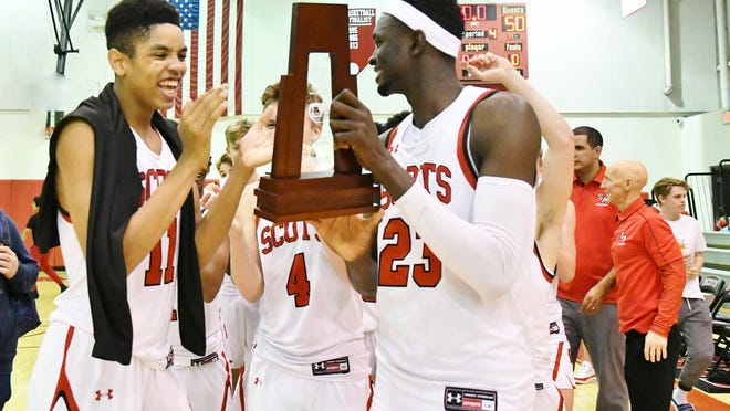 St. Andrew's junior Josh Minott, left, and senior Yussif Basa-Ama, right, celebrate their team's district championship victory over Cardinal Newman.