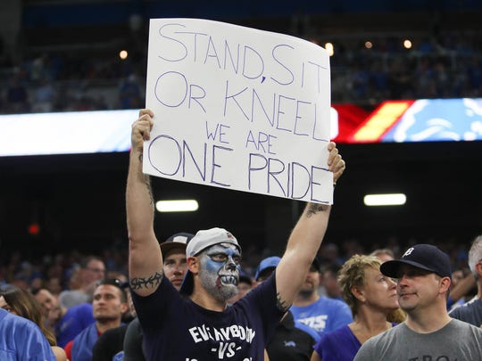 A Detroit Lions fan shows his support after the statements made by President Donald Trump about NFL players protesting the national anthem. before a game against the Falcons, Sunday, Sept. 24, 2017 at Ford Field.