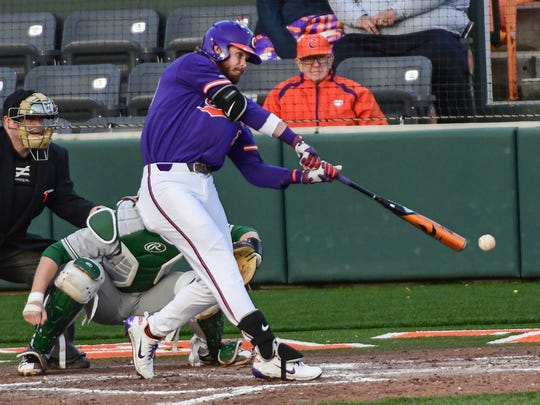 Clemson junior first baseman Seth Beer (28) hits a ball against William and Mary during the bottom of the fourth inning on Saturday at Doug Kingsmore Stadium in Clemson.