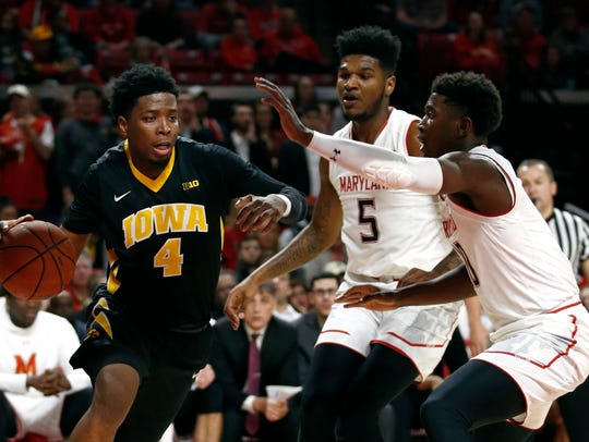 Iowa guard Isaiah Moss, left, drives against Maryland