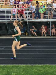 Oak Harbor's Annie Quisno competes in the 800 on Saturday