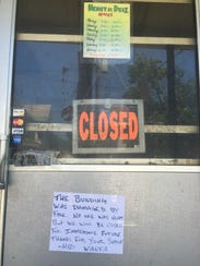 A sign was taped to the window Tuesday announcing Henry