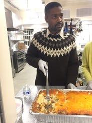 Infinite Culcleasure, 44, serves dinner at an event