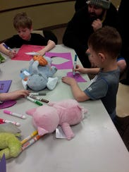 Children enjoy crafts at the Teddy Bear Sleep Over