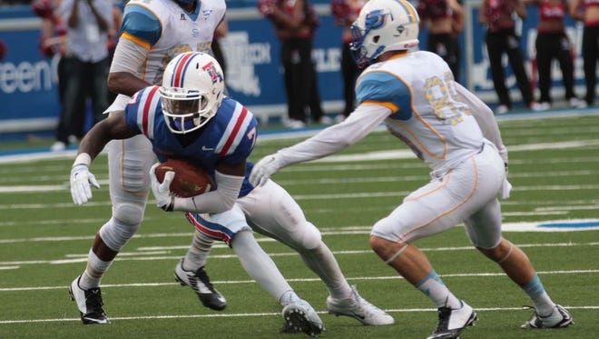 Louisiana Tech safety Xavier Woods, center, returns an interception in Saturday's win over Southern. The Bulldogs had three turnovers.