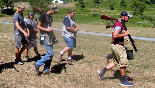 Members of the Troy Junior Sportsmen move to the next station during the shotgun competition at last week's NRA Youth Hunter Education Challenge championship near Mansfield.