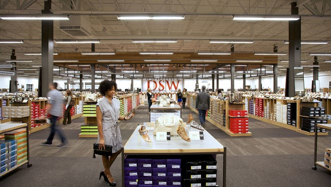 The interior of a Designer Shoe Warehouse store.