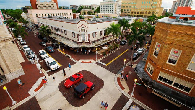 People and traffic flow through downtown Fort Myers on Friday (7/14/17) during the start of the monthly Mystery Walk event.