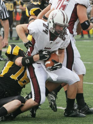 Don Bosco's Dillon Romain getting tackled by Centerville's Tyler Replogle during the Ohio vs USA Kirk Herbstreit Challenge at the University of Cincinnati on Sept. 16, 2006.