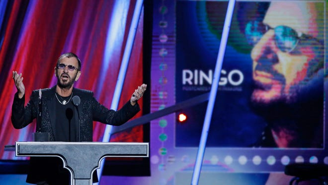 Ringo Starr speaks at the Rock and Roll Hall of Fame Induction Ceremony Sunday, April 19, 2015, in Cleveland.
