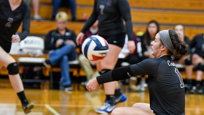Henderson's Maggie Vincent (11) with a dig as Henderson County plays long-time rival Caldwell County in the Second Region Volleyball Tournament championship at Trigg County High School Thursday, October 26, 2017.