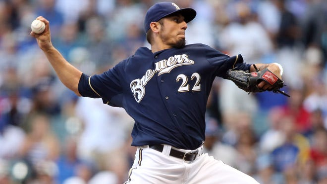 Milwaukee Brewers starting pitcher Matt Garza throws a pitch against the New York Mets during the first inning at Miller Park.