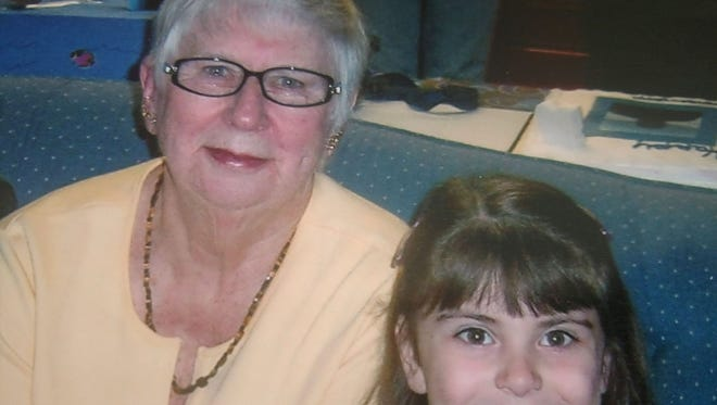 Eleanor McGarigle, left, lived for a time in Michigan with her son and daughter-in-law. McGarigle's daughter, Debra Kostiw, said the couple financially abused the woman. She died in March, shortly before she was to return to Monroe County. She is pictured with granddaughter Olivia Kostiw.