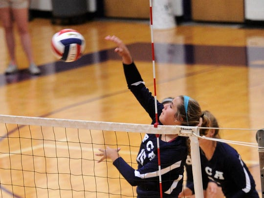 Hawley's Gabi Speed (15) goes for a kill during the Big Country FCA All-Star volleyball game at Wylie's Bulldog Gym on Saturday. Her North team won 25-22, 25-17.