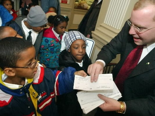 In 2002, then-York Mayor John Brenner created the 332 Fund   or the Happy Meal appeal, as it was also called   in an attempt to close a $1 million budget gap in the city s budget. Here Shakwon Jamison, left, then a second-grader at Logos Academy in York City, hands a check to Brenner to help with the budget problems.