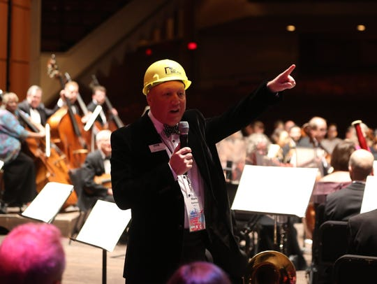 Wearing a hard hat, Milwaukee Symphony President Mark