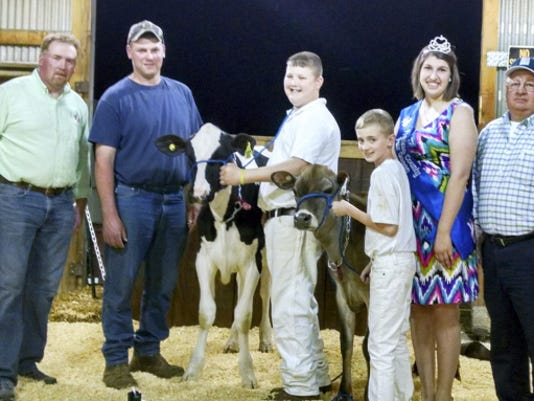 Pictured at the April 18 Franklin County 4-H Dairy Calf Sale are, from left, Jeff Benedict, pedigree reader; Eric Niswander, consignor of the high selling calf; dairy club member Colton Hartman, Mercersburg, with the high selling calf Eden-View Equat Helium; dairy club member Caden Hudson, Greencastle, with a Jersey calf that also was sold; Franklin County Fair Queen Brittany Newlin, Chambersburg; and 4-H dairy calf sale chairman Dave Koons.