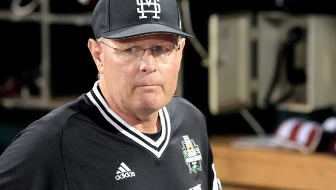 Mississippi State coach Gary Henderson stands in the dugout following an NCAA College World Series baseball elimination game against Oregon State in Omaha, Neb., Saturday, June 23, 2018. Oregon State won 5-2. (AP Photo/Nati Harnik)