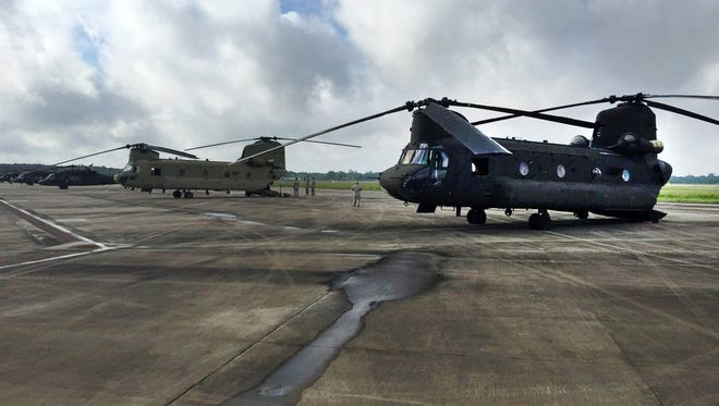 Two Mississippi Air National Guard CH-47  Chinook helicopters (foreground) arrive in Hammond, La. Momday, Aug. 15, 2016.
