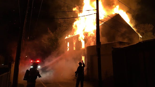 Fire fighters battle a fire on Susquehanna Avenue in York Thursday night.