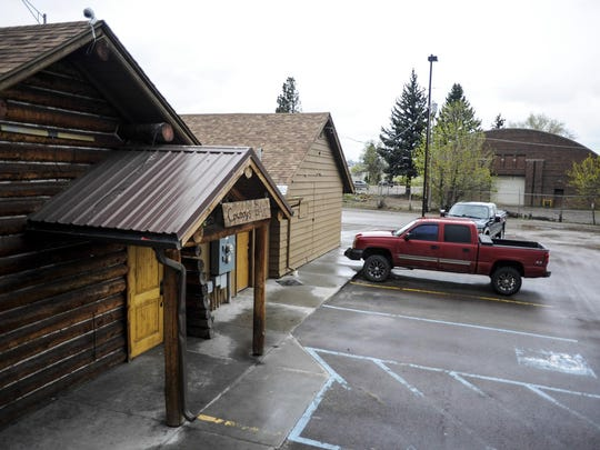 By summer, developers plan to begin renovating a 10,000-square-foot barrel building, seen here behind the Cowboy's Bar, for restaurant and retail use.
