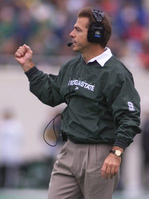 In this file photo, Michigan State coach Nick Saban calls a play during the game with Iowa on Oct. 2, 1999, in East Lansing, Mich.  The Spartans beat the Hawkeyes 49-3.