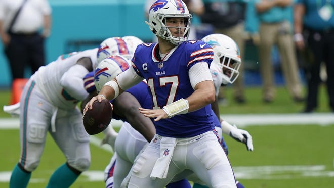 Buffalo Bills quarterback Josh Allen (17) looks to pass, during the second half of an NFL football game against the Miami Dolphins, Sunday, Sept. 20, 2020, in Miami Gardens, Fla.