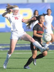 Cooper's Caylee Collier (16) kicks the ball as an Amarillo Caprock player looks on. Cooper beat Caprock 1-0 in the Region I-5A bi-district playoff game at the Frenship Soccer Complex on Friday, March 30, 2018 in Wolfforth.