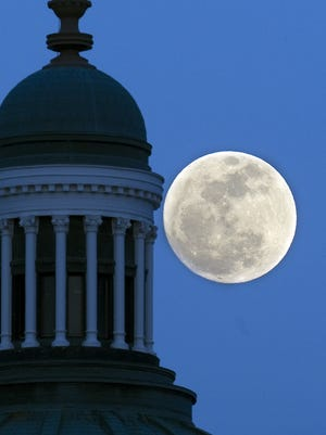 A Perigee moon rises over the Indiana Statehouse, Friday, March 18, 2011. The full moon appeared as much as 14 percent larger than a regular full moon because the moon's orbit was closer than normal.