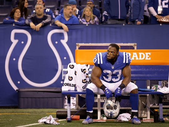 Indianapolis Colts running back Robert Turbin (33) sits dejected all by himself on the bench at the end of  their NFL football game Sunday, December 11, 2016, afternoon at Lucas Oil Stadium. The Colts lost to the Texans 22-17.