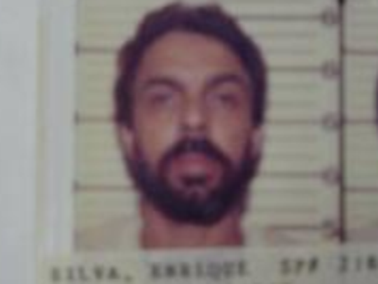 A decades-old photo of Enrique Silva appears among escapees at NJ Department of Correction's website.