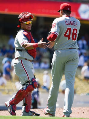 Philadelphia Phillies' Jeanmar Gomez, right, celebrates with Carlos Ruiz after the team's win Wednesday against the Los Angeles Dodgers in Los Angeles to conclude their six-game road trip.