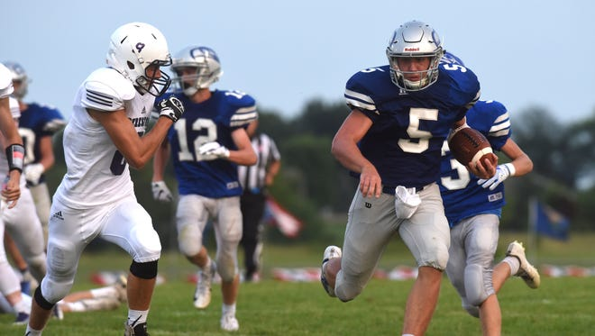 Bridgewater-Emery/Ethan Brady Hawkins (5) runs the ball past Beresford players at Beresford High School Friday, Aug. 17, 2018.