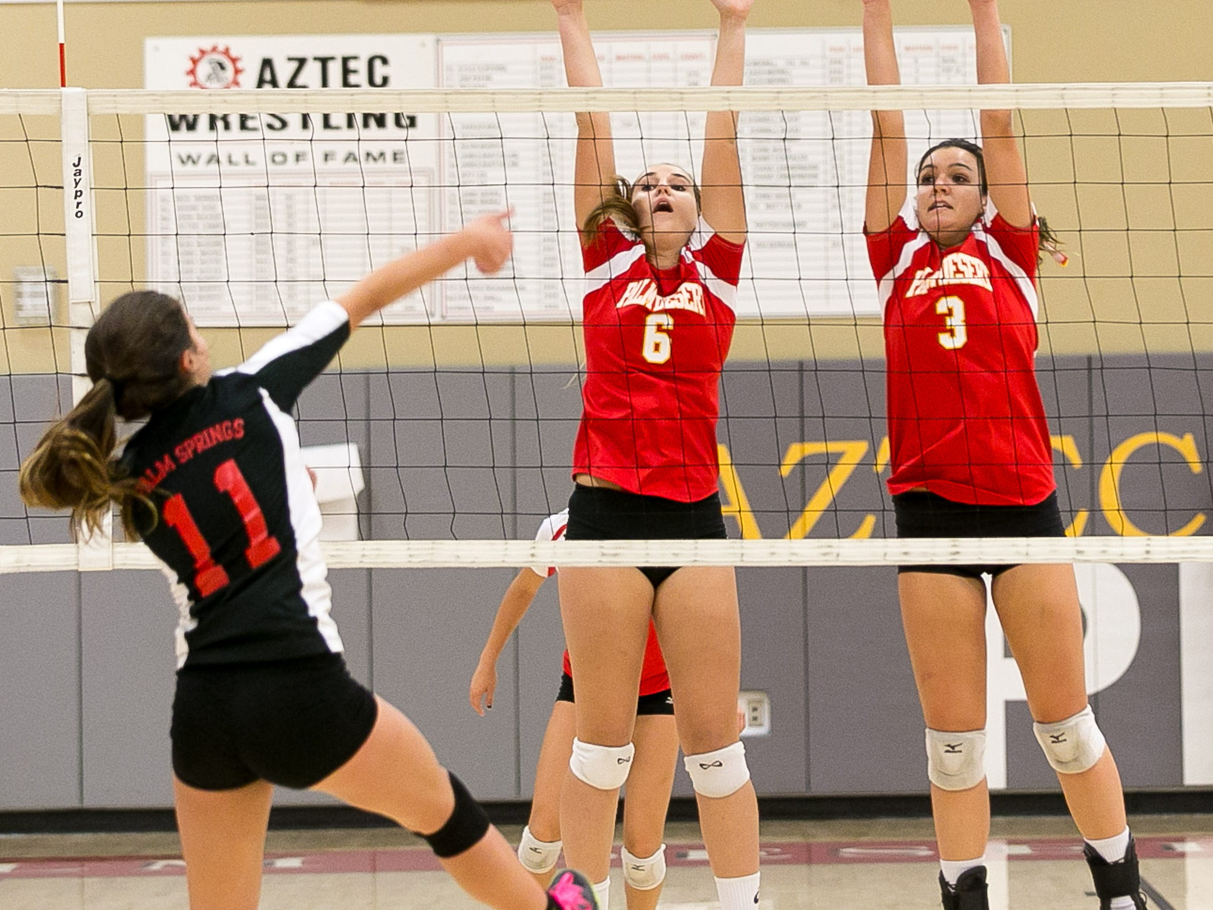Palm Desert's Hailey Bucklin (No. 6) and Savannah Sharp (No.3) tries to block a shot from Palm Springs' Mary Lake (No. 11) in a DVL volleyball game held at Palm Desert High School Thursday evening, October 16, 2014. Photo by Gerry Maceda, Special to The Desert Sun