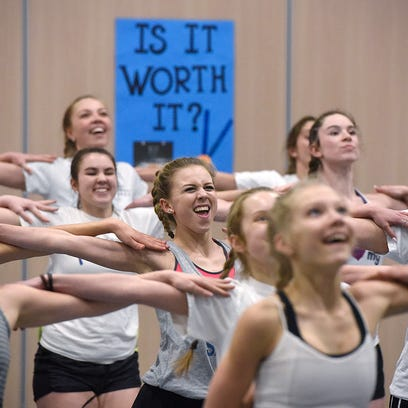 Sartell dance team members practice their high-kick routine Tuesday at Pine Meadow Elementary in Sartell in preparation for state tournament competition this weekend in Minneapolis.