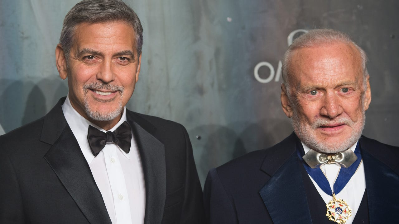 At a London event celebrating the 60th anniversary of the OMEGA Speedmaster, actor George Clooney was joined by astronaut Buzz Aldrin and stars including Liv Tyler, Ellie Goulding and Gemma Arterton. (April 27)