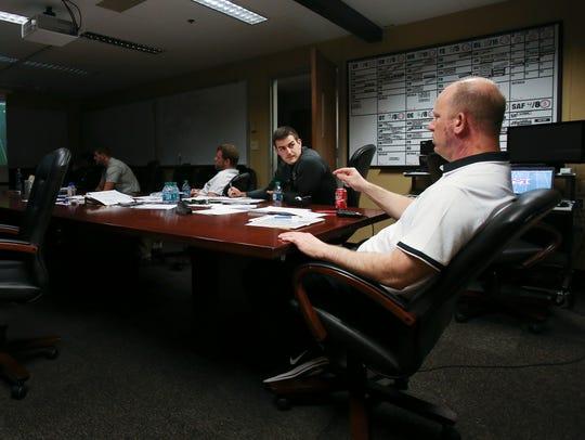 New Purdue head football coach Jeff Brohm, right, speaks