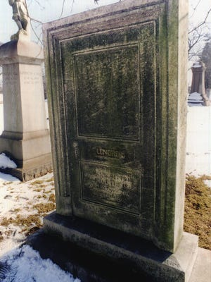 This tombstone is a tribute to Edgar Allan Poe.