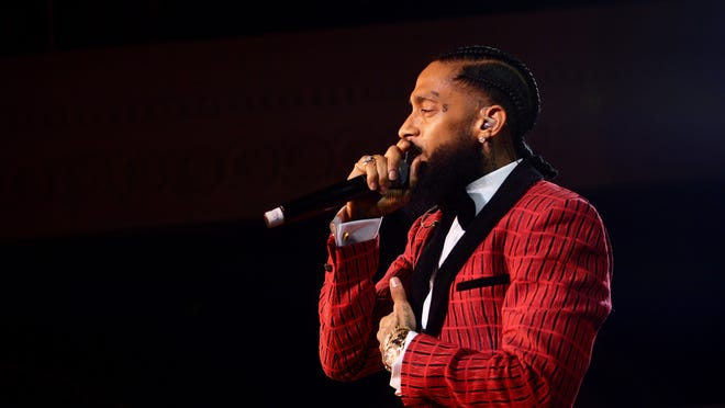 Rapper Nipsey Hussle, seen here performing at a pre-Grammy party in February, was shot and killed on March 31.